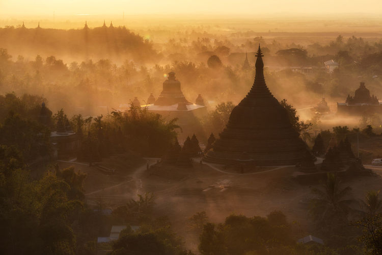 Architecture Cultures Foggy Morning Myanmar No People Outdoors Pagoda Place Of Worship Religion Silhouette Sunrise Tree
