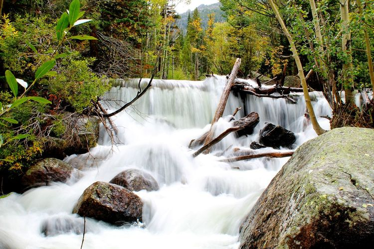 Water Flowing Through Rocks At Rocky Mountain National Park