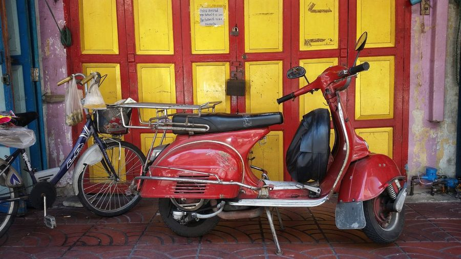 Architecture Bicycle Building Exterior Built Structure Day Land Vehicle Mode Of Transport Motorcycle No People Old City One Person Outdoors Red Retro Stationary Transportation Vespa Vintage Vintage Motorcycles