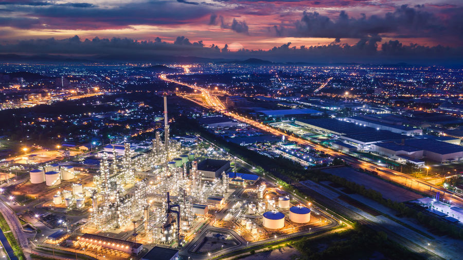 Refinery industry zone at night and lighting cityscape with twilight sky background