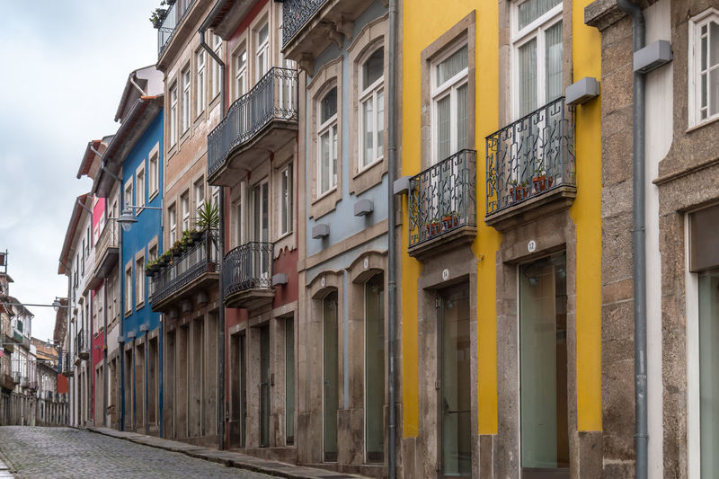 Buildings of the traditional architecture of Braga, Portugal Apartment Architecture Building Building Exterior Built Structure City Day Direction House In A Row Multi Colored Nature No People Old Outdoors Residential District Row House Sky Street Town Window Yellow