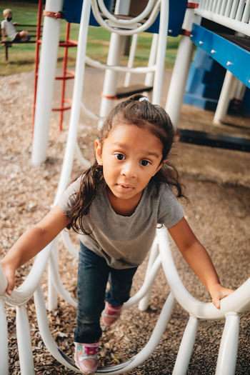 Portrait of cute girl playing in playground