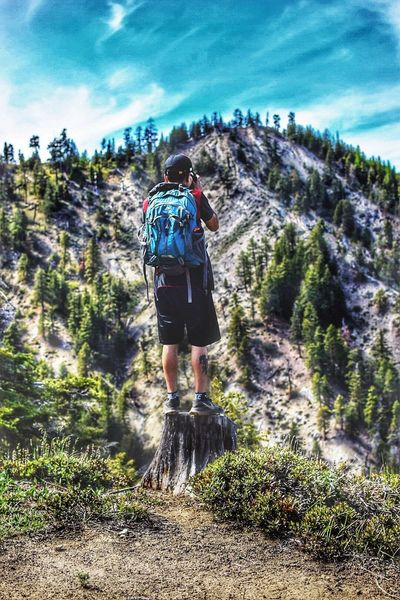 Adventure Rear View Backpack Mountain Hiking Healthy Lifestyle Nature Exploration Walking Extreme Sports Leisure Activity Sport Lifestyles Day Motion Landscape Sky Mountain Range