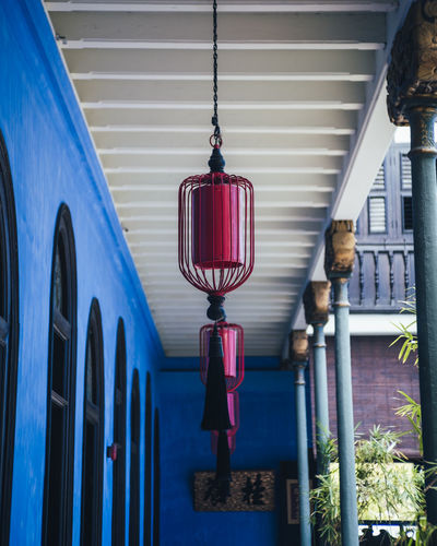Built Structure Building Exterior Hanging Architecture Lighting Equipment No People Red Day Outdoors Focus On Foreground Building Decoration Illuminated Low Angle View Transportation Lantern Window Mode Of Transportation Street Light Electric Lamp Decor Indoors  Arabic Blue Art