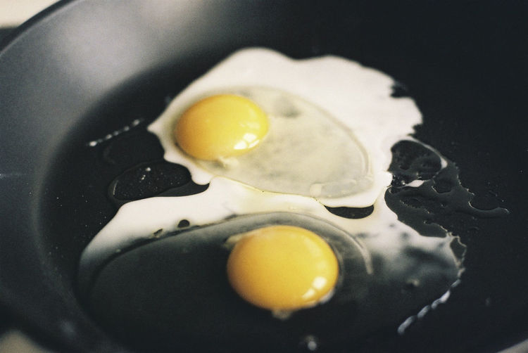 High Angle View Of Eggs In Cooking Pan