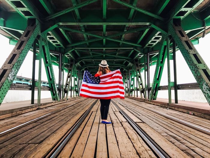 One Person Lifestyles Bridge - Man Made Structure Independence Day Fourth Of July USA FLAG EyeEm Selects July 4th IPhone 7 Plus The Week Of Eyeem EyeEm Best Shots City Life Flags In The Wind  The Week On Eyem EyeEm Team EyeEm Patriotism Flag Flags USA Patriotic EyeEm Gallery Lifestyle Streetphotography Bridge Bridges Bridge View Bridgeporn Bridge Over Water Bridge Photography Bridgesaroundtheworld Bridges_aroundtheworld Bridge Porn Bridgescape Bridge Over The River Bridgeview Bridge Construction Bridge Of Sighs Bridge Over Troubled Water Bridgeport  Bridgetown Bridge Architecture Bridge Railing Bridge Span Bridge To Nowhere Bridges I've Seen Bridge Camera Bridgeoflions Bridgestone Bridgecamera Bridges Of The World Bridgenorth Done That.
