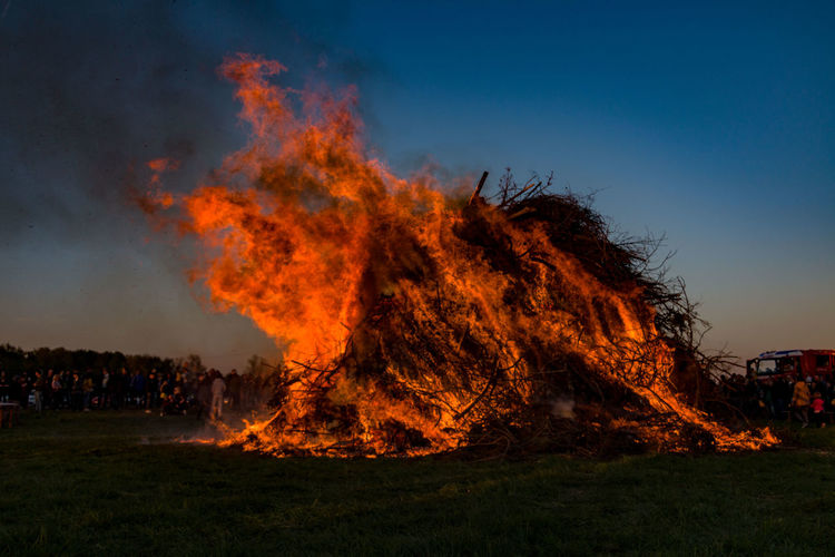 Burning Fire - Natural Phenomenon Fire Flame Heat - Temperature Environment Smoke - Physical Structure Nature Environmental Issues Sky Land Environmental Damage Motion Warning Sign Sign Forest Fire Bonfire Pollution Accidents And Disasters Destruction Air Pollution Outdoors Power In Nature