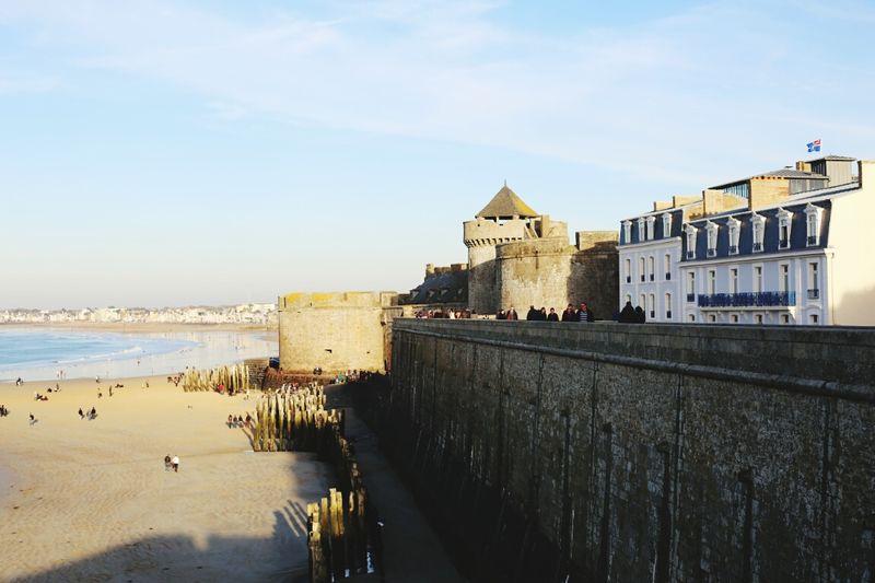 Castle at beach against sky