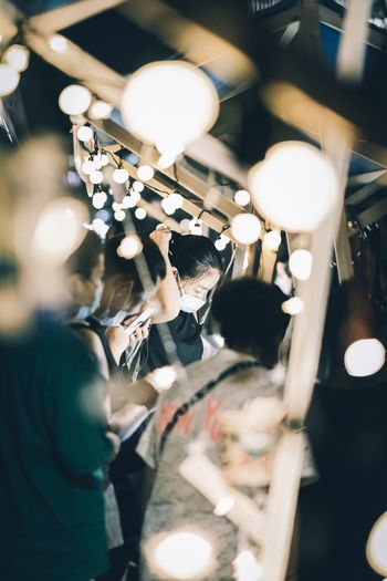 High angle view of people at illuminated nightclub