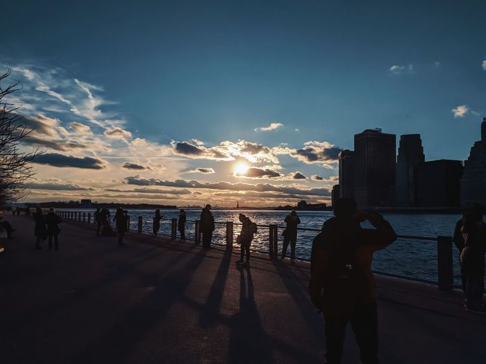 Reflection Outdoor Street Photography City Life NYC New York Downtown Sundown Dusk Evening Clouds Cityscape City View  City Life Waterfront City Water Sea Sunset Sand Cityscape Blue Sky Horizon Over Water Urban Skyline Dramatic Sky Silhouette Romantic Sky Moody Sky Storm Cloud The Mobile Photographer - 2019 EyeEm Awards