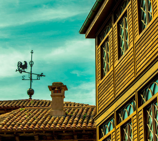 Landscape with houses and vane of a rooster. Asturias Home Animal Architecture Building Building Exterior City Cute Day Decoration Direcction House Lovely No People One Animal Outdoors Roof Rooster Sky Skyscraper Tiles Vane Weather Vane Wind Window