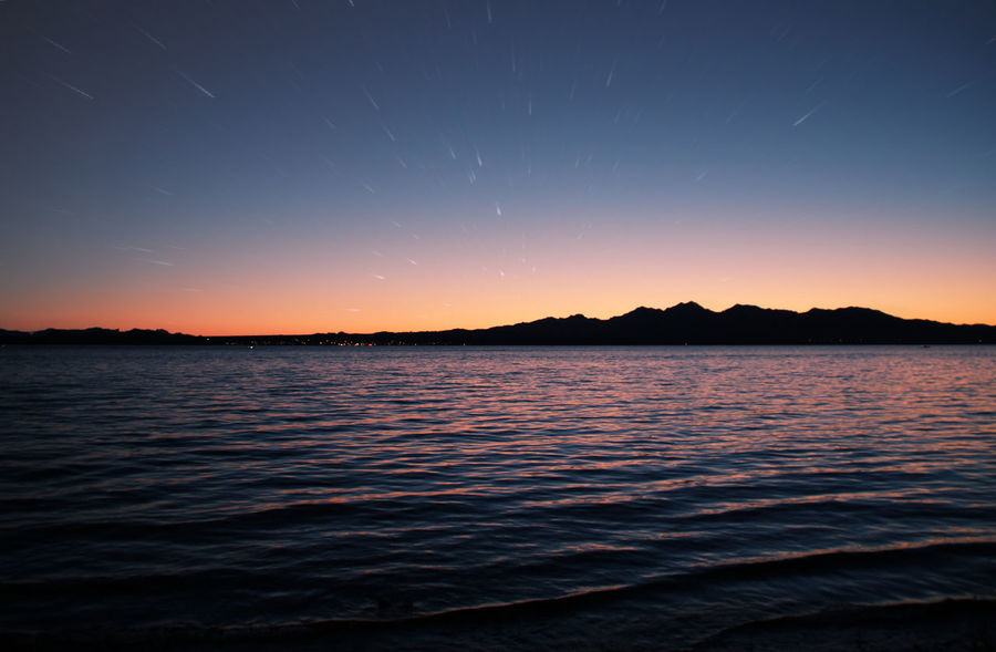 ease of mind Atmosphere Beauty In Nature Blue Idyllic Long Exposure Mountain No People Non-urban Scene Orange Color Outdoors Scenics Sea Sea At Night Sea View Seascape Stars Startrails Summer Summer Nights Sunset Sunset Silhouettes Tranquil Scene Tranquility Vibrant Color Water