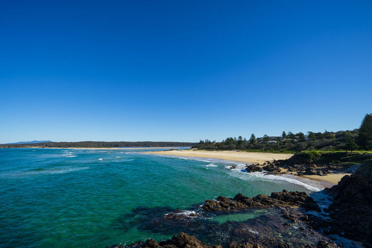 Tuross Head, New South Wales, Australia. Australia Tuross Head Tuross Lake Bay Beach Beauty In Nature Blue Clear Sky Copy Space Day Eurobodalla Idyllic Nature No People Outdoors Rock Rock - Object Scenics - Nature Sea Sky Solid Tranquil Scene Tranquility Turquoise Colored Water