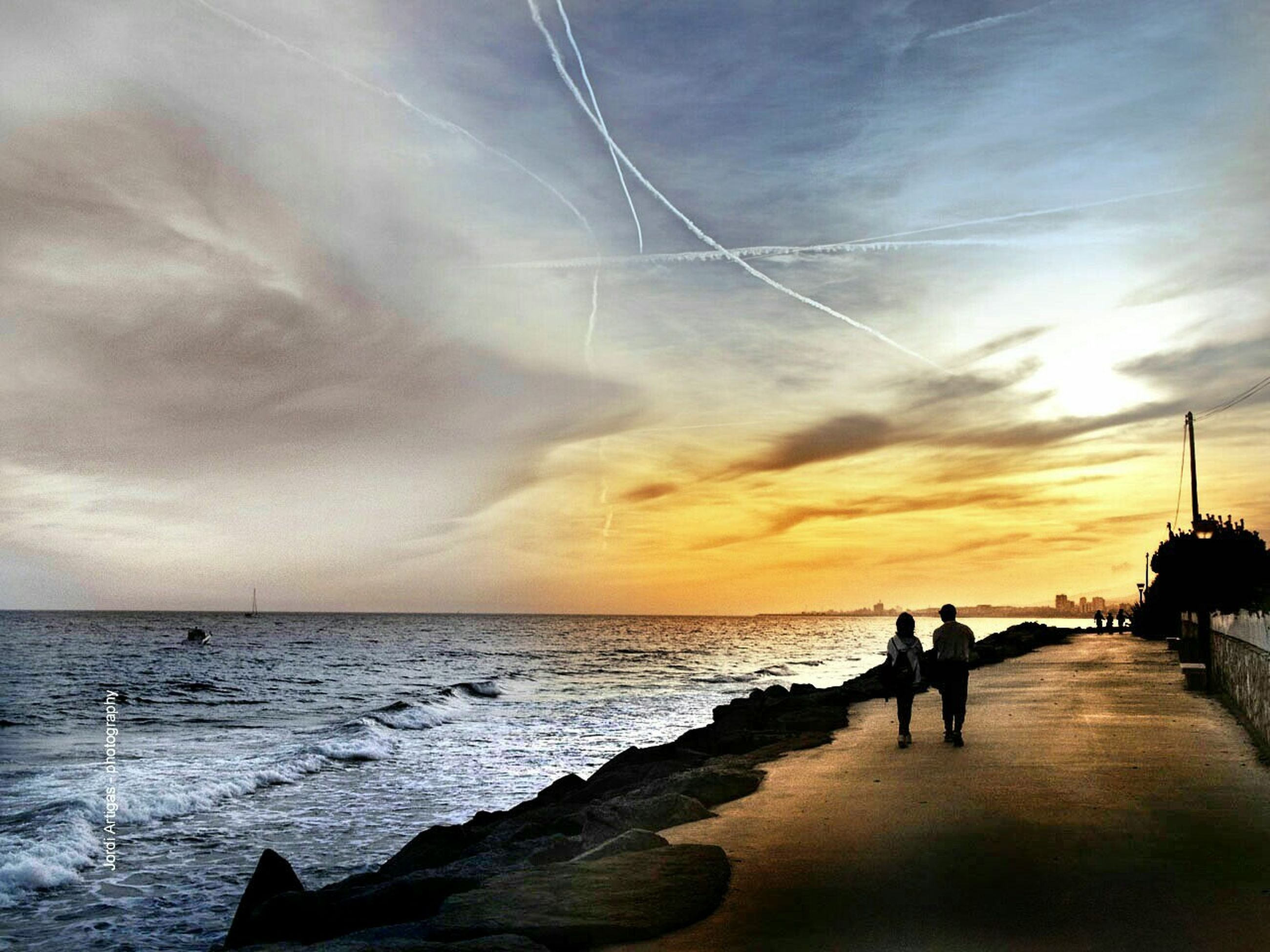 sea, water, horizon over water, sky, sunset, silhouette, scenics, beach, cloud - sky, beauty in nature, tranquil scene, tranquility, shore, men, nature, idyllic, leisure activity, cloudy, cloud