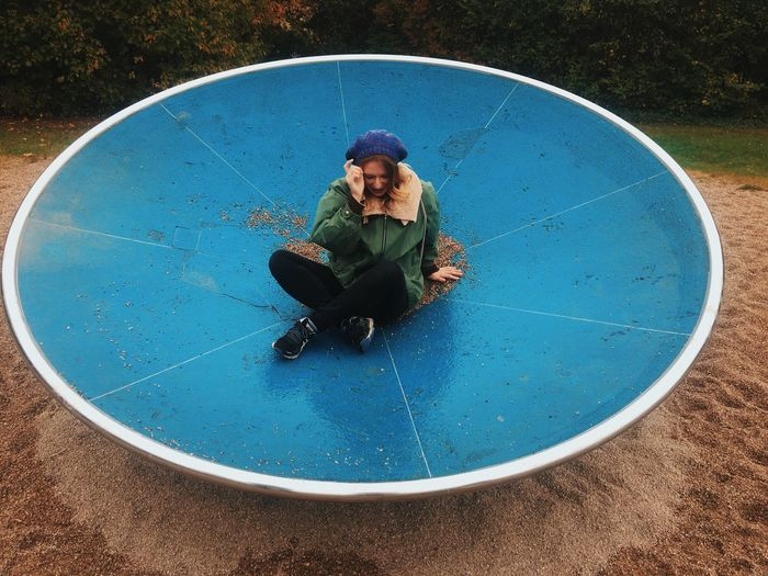 Full Length Leisure Activity Lifestyles One Woman Young Women Nature Playground Enjoyment Geometric Shape Fun Blue Round Summer Day Outdoors