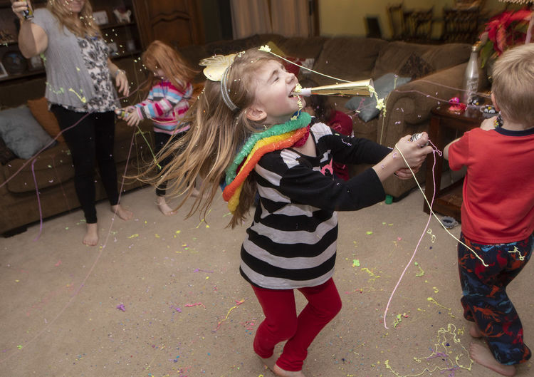 A family celebrates New Year's Eve on December, 31 2018 at their home with confetti, silly string, noise makers and dancing. Silly String Siblings Family Love Celebration Happiness Joy Joyful Party New Year's Eve New Year's Eve 2019 Fun Dancing Children Childhood Indoors  Lifestyles Girl Boy Leisure Activity Group Of People Positive Emotion