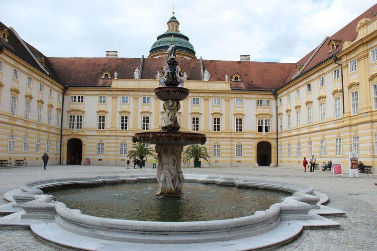 Fountain by melk abbey against sky