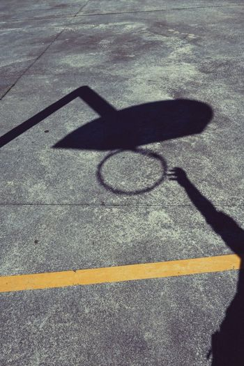 man playing basketball in the street, basket shadow silhouette person Man Shadow Silhouette Basket Basketball Basketball - Sport Sport Streetphotography Street Court Field Outdoors Hoop Ground Textured  Playing Day High Angle View Focus On Shadow