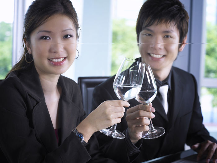 business couple work as team Business Celebration Alcohol Cheerful Couple - Relationship Day Drink Drinking Glass Food Food And Drink Friendship Happiness Holding Looking At Camera Lunch Meeting Portrait Refreshment Smiling Toothy Smile Two People Well-dressed Wine Wineglass Young Adult Young Women