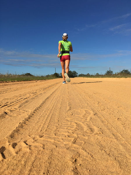 Athlete on clay road Athlete Day Full Length Leisure Activity Lifestyles One Person Outdoors Runner Sky Sports Clothing Sports Photography