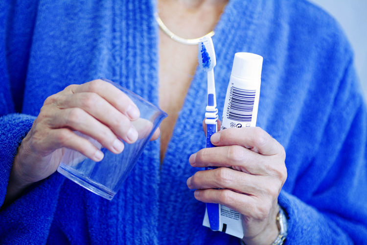 Close-up of a hand holding toothbrush