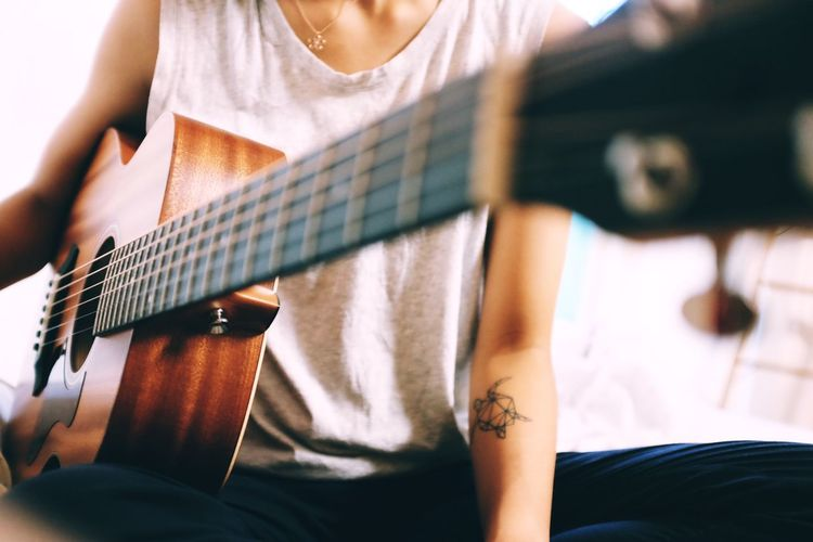 Arts Culture And Entertainment Close-up Day Fretboard Guitar Guitar Love Guitarist Human Hand Indoors  Lifestyles Midsection Music Musical Instrument Musical Instrument String Musician One Person People Playing Plucking An Instrument Real People Skill