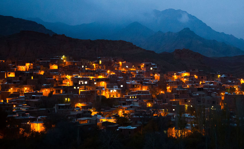 A general view of Abyaneh historical village at dusk in Iran's Isfahan province November 17, 2013. Abyaneh Aerial View Building Exterior City Life Cold Temperature Community Composition Development Historical Building Human Settlement Night Outdoors Perspective Residential District Road Season  Snow Sunset Top Perspective Weather Winter Market Bestsellers August 2016 Bestsellers Fresh On Market 2018