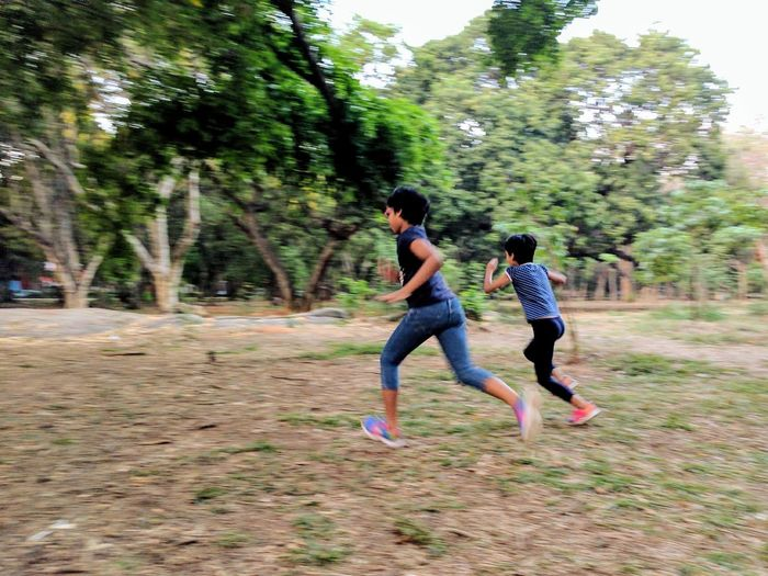 Kids running and playing at Cubbon Park, Bangalore Happiness Tree Fun Motion People Child Two People Full Length Casual Clothing Girls Exercising Outdoors Park Childhood Real People Females Playing Togetherness