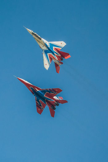 Aerobatics Air Force Air Vehicle Airplane Airshow Blue Clear Sky Day Fighter Plane Flying Low Angle View Mid-air MIG 29 Military Military Airplane No People Outdoors Russian Knight Sky Su-27 Vapor Trail