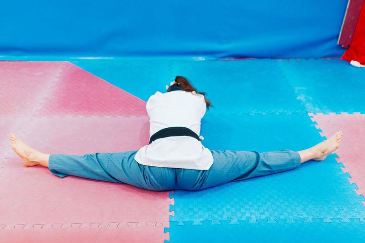 Full length of man lying on swimming pool