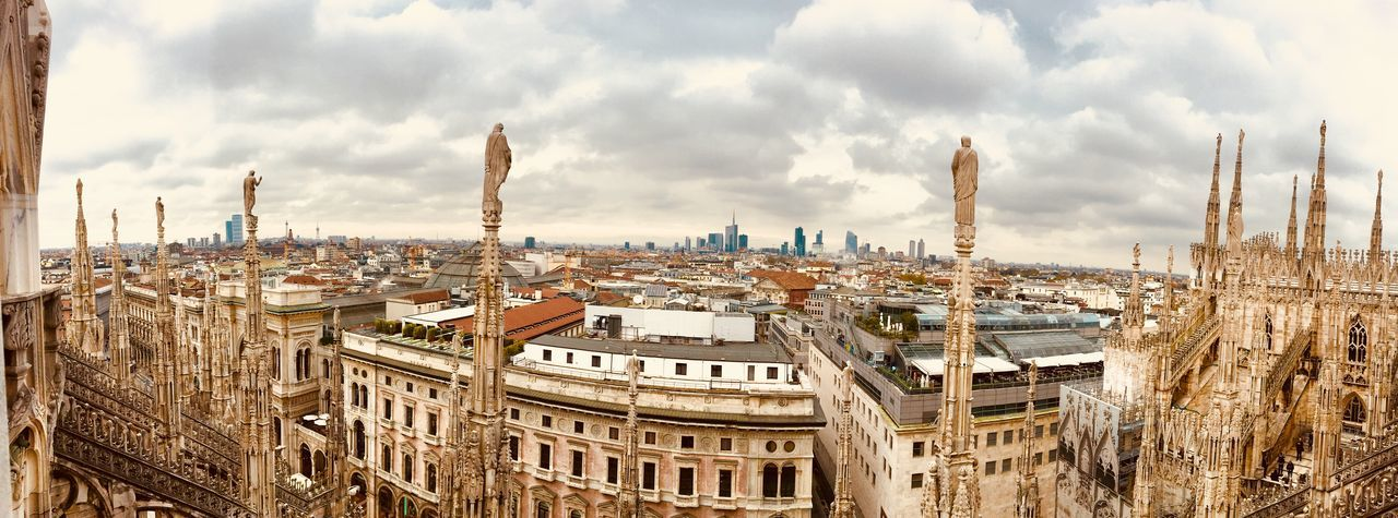 Neighborhood watch Milan Cathedral Architecture Building Building Exterior Built Structure City City Life Cityscape Cloud - Sky High Angle View Landscape Office Building Exterior Panoramic Sky Travel Travel Destinations Urban Skyline The Traveler - 2018 EyeEm Awards