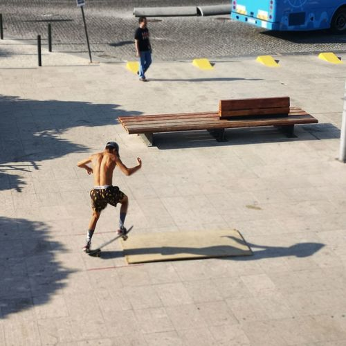 High angle view of skateboard on road