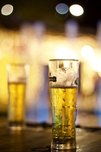 Alcohol Refreshment Drink Food And Drink Beer Glass Beer - Alcohol Drinking Glass Household Equipment Bar - Drink Establishment Beer Glass Indoors  Focus On Foreground Pint Glass Close-up Table Celebration Still Life Cold Temperature Bar Counter Frothy Drink Lager Nightlife Happy Hour