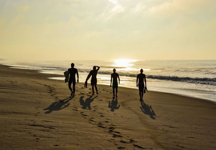 Four surfers at