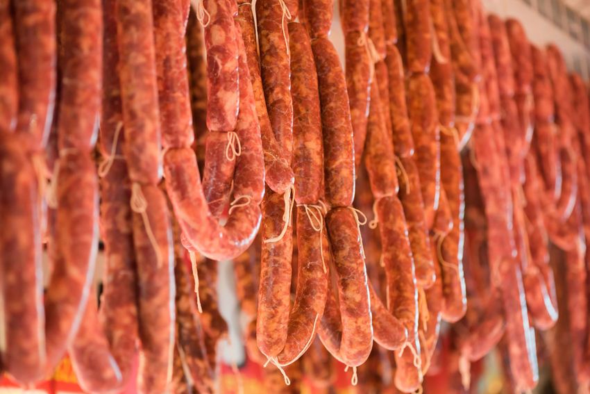 sausages Food And Drink Food Freshness Meat Close-up No People Abundance Hanging Large Group Of Objects Focus On Foreground In A Row Retail  Indoors  Sausage Market Dried Food Red Meat Still Life Selective Focus Business Beef Snack Chinese Food