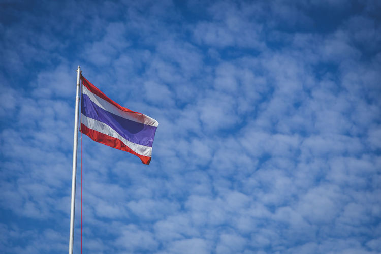 National Flag Of Thailand Blue Cloud - Sky Day Flag Low Angle View National Flag National Flags Nature No People Outdoors Patriotism Sky Wind