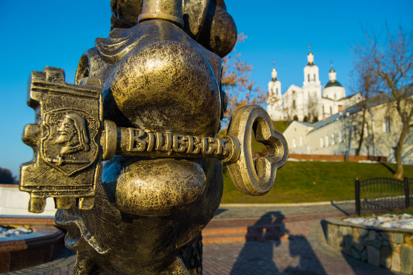 The key to the city of Vitebsk Bronze Key Bronze Statue Bronze Sculpture Composition Cityscape Vitebsk,Belarus From My Point Of View By Ivan Maximov Eyeem Photo The Week On EyeEm Cathedral Landscape Belarus City Great Outdoors Focus On Foreground Perspective Simbol Of City Simbol Business Finance And Industry Architecture Outdoors Sky The Street Photographer - 2018 EyeEm Awards