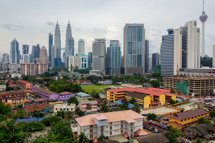 modern buildings at Kuala Lumpur Architecture Building Exterior Built Structure City Cityscape Day Kampung Baru KL TOWER Modern No People Outdoors People Sky Skyscraper Suria KLCC Tall - High Telecommunications Equipment Tower Travel Destinations Tree Twin Tower Urban Skyline