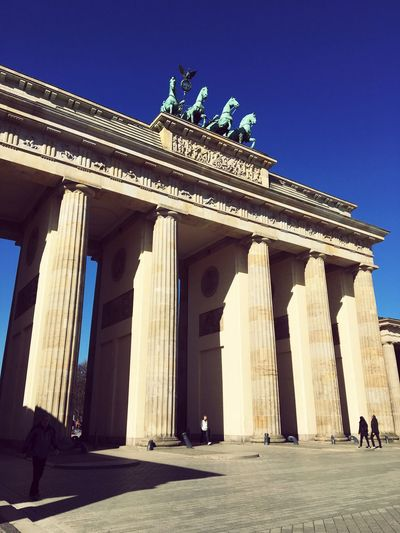 Architecture Built Structure Statue Travel Destinations Architectural Column History Building Exterior Sculpture Tourism Clear Sky Pediment Blue Outdoors Travel Real People Day Low Angle View Men City People Brandenburg Gate