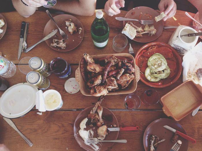 Men eating chicken wings