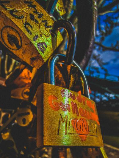 Close-up of love padlocks hanging on metal