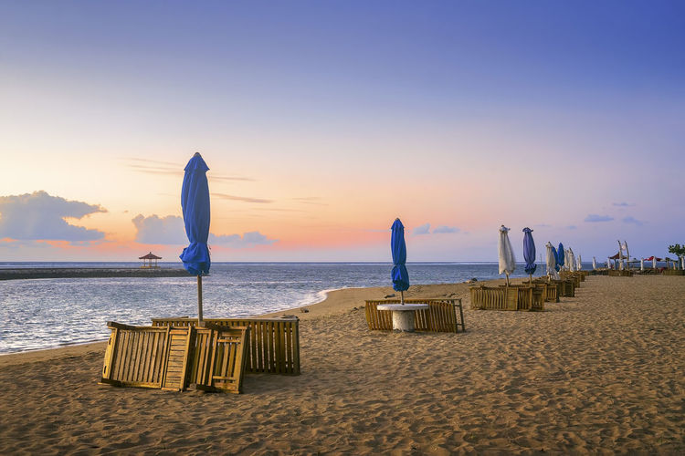 Karang beach Sanur, Bali, Indonesia in the morning Bali EyeEmNewHere Holiday INDONESIA Beach Beauty In Nature Blue Day Horizon Over Water Hotel Nature Outdoors Sand Sanur Beach Scenics Sea Sky Sunrise Sunset Table Tranquil Scene Tranquility Travel Destinations Vacations Water