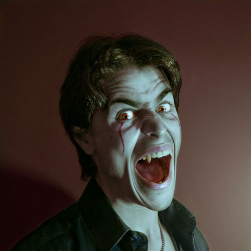 Portrait of man with face paint shouting