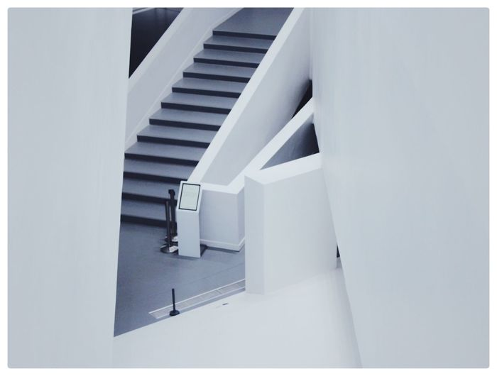 Steps And Staircases Staircase Steps Railing Architecture White Color Indoors  High Angle View Built Structure No People Day