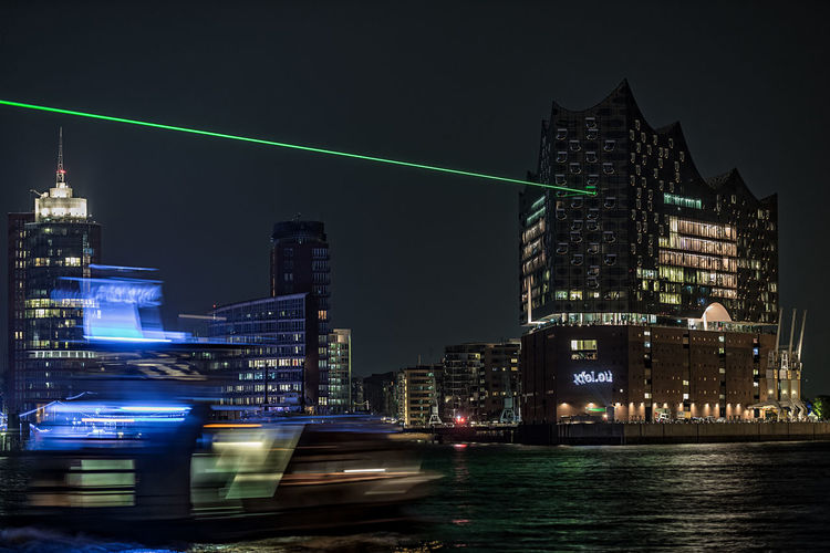 green light 2 Elbe River Hafencity Hamburg Hamburg Harbour Architecture Blured Motion Boat In Motion Building Exterior Built Structure City Cityscape Elbphilharmony Green Laser Illuminated Laser Lights  Modern Night No People Outdoors Sky Skyscraper Tall Tall - High Tower Transportation Travel Destinations Urban Skyline Waterfront