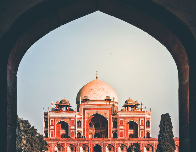 A view of Humayun's Tomb from the entry gate. Architecture India New Delhi Travel UNESCO World Heritage Site Ancient Arch Architecture Building Exterior Built Structure City Clear Sky Day Dome History Monument Nature No People Outdoors Religion Sky The Past Tourism Travel Travel Destinations