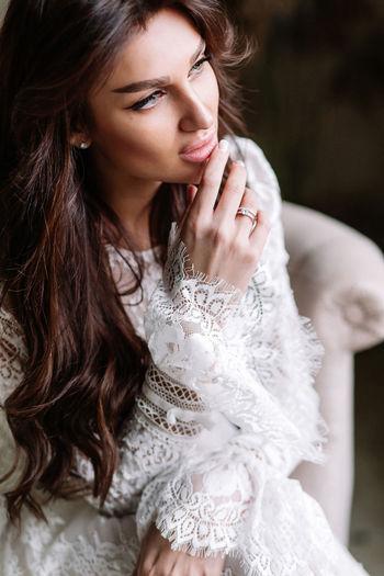 Beautiful young woman looking away