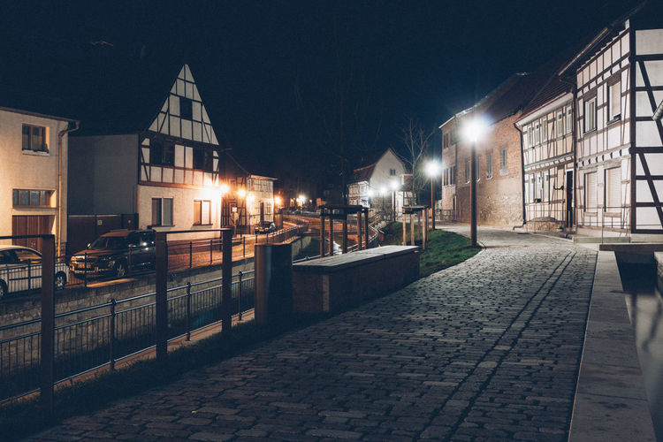 Alone in the streets II Architecture Building Exterior Built Structure Car City Dark Darkness And Light Illuminated Illumination Long Long Exposure Night Nightphotography No People Outdoors Reflection Sky Street Light Thuringen Thuringia Timbered House Village Water
