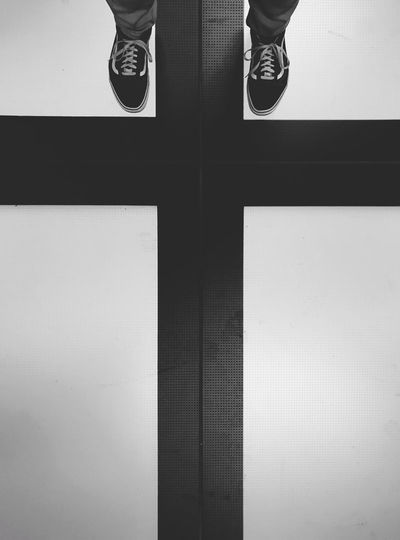 Black & White Cross Religious Art Black And White Blackandwhite Bnw_captures Bnw_collection Bnw_life Bnw_society Bw_collection Bw_lover Human Body Part Human Foot Human Leg Low Section Monochrome Monotone One Person Real People Religion Shoe Standing Vans