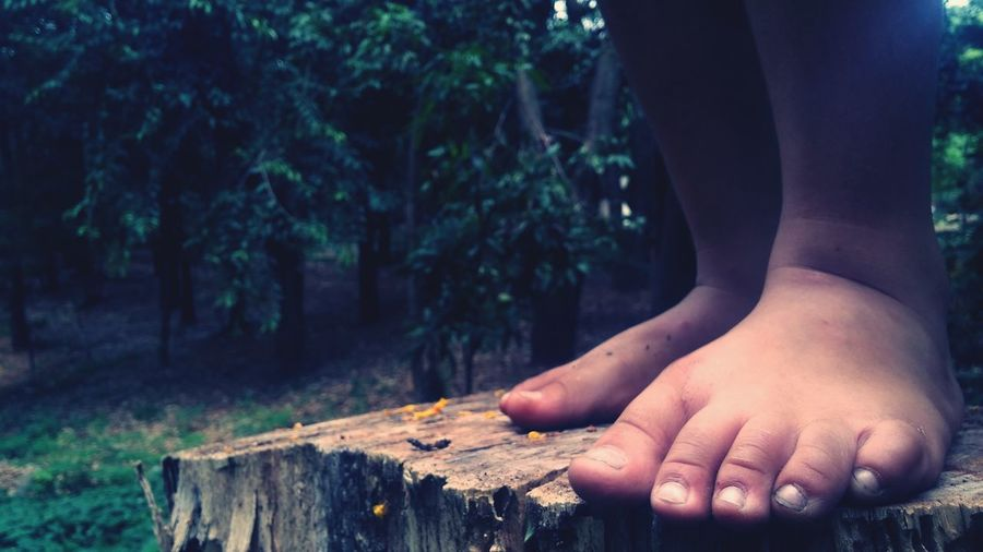 Close-up of bruised feet